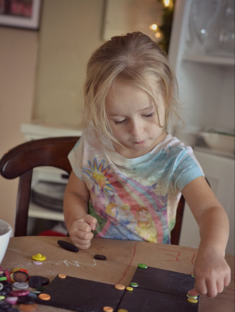 DIY Chalkboard Coaster Set | Your kids will love helping out on this DIY chalkboard coaster project. They can help pick and apply buttons for decoration!