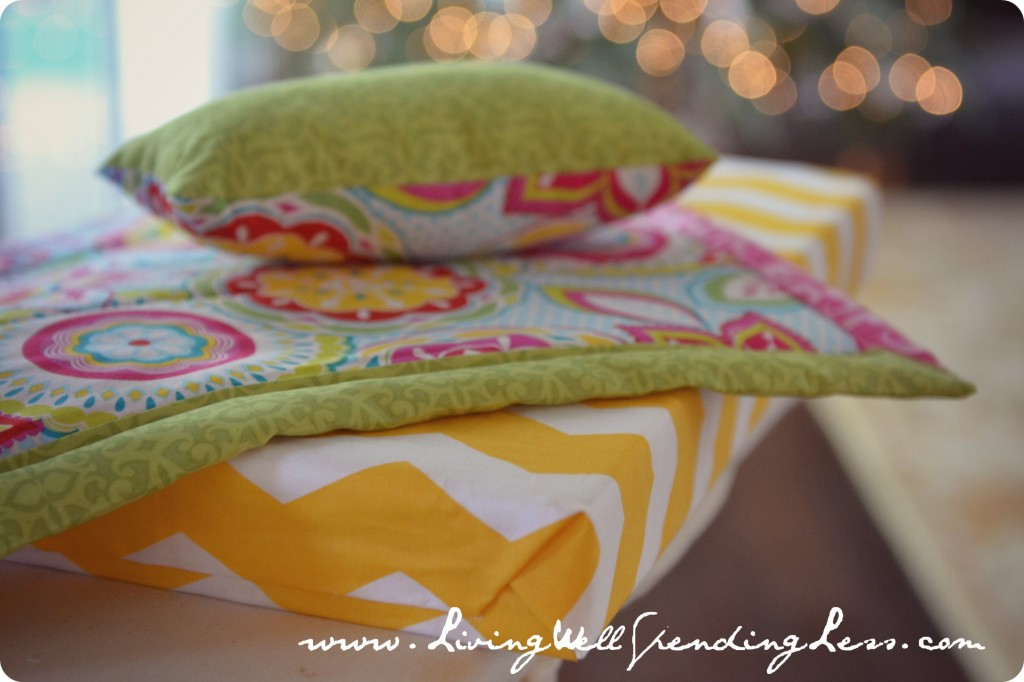 The matching pillow and contrasting sheet look great with our American Girl Doll bed.