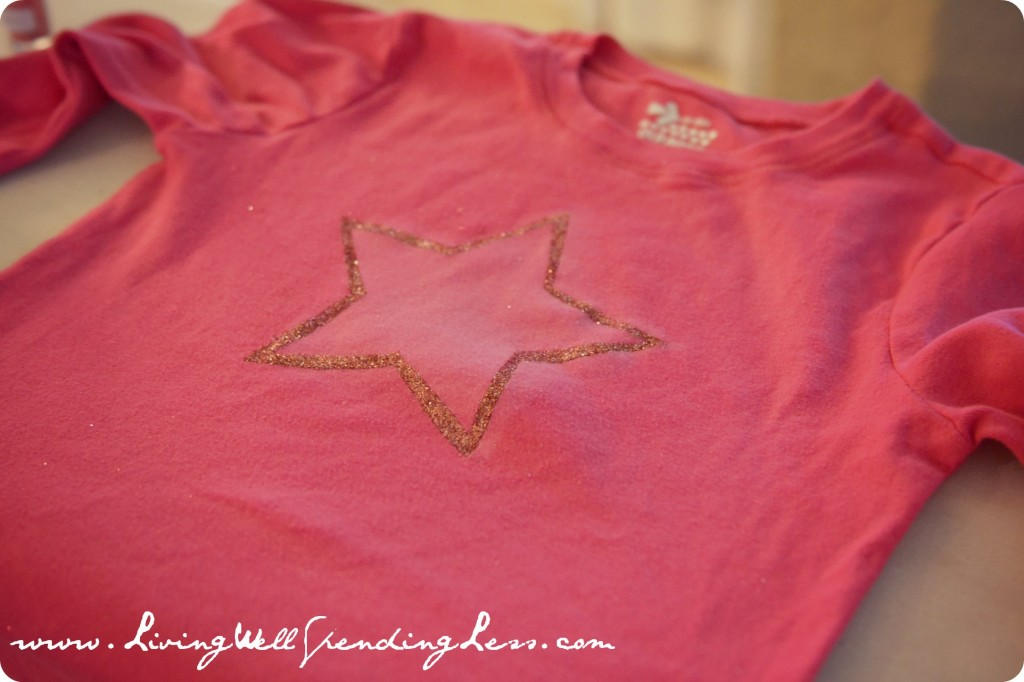 Finished glitter star shaped vintage t-shirt is ready to be worn.