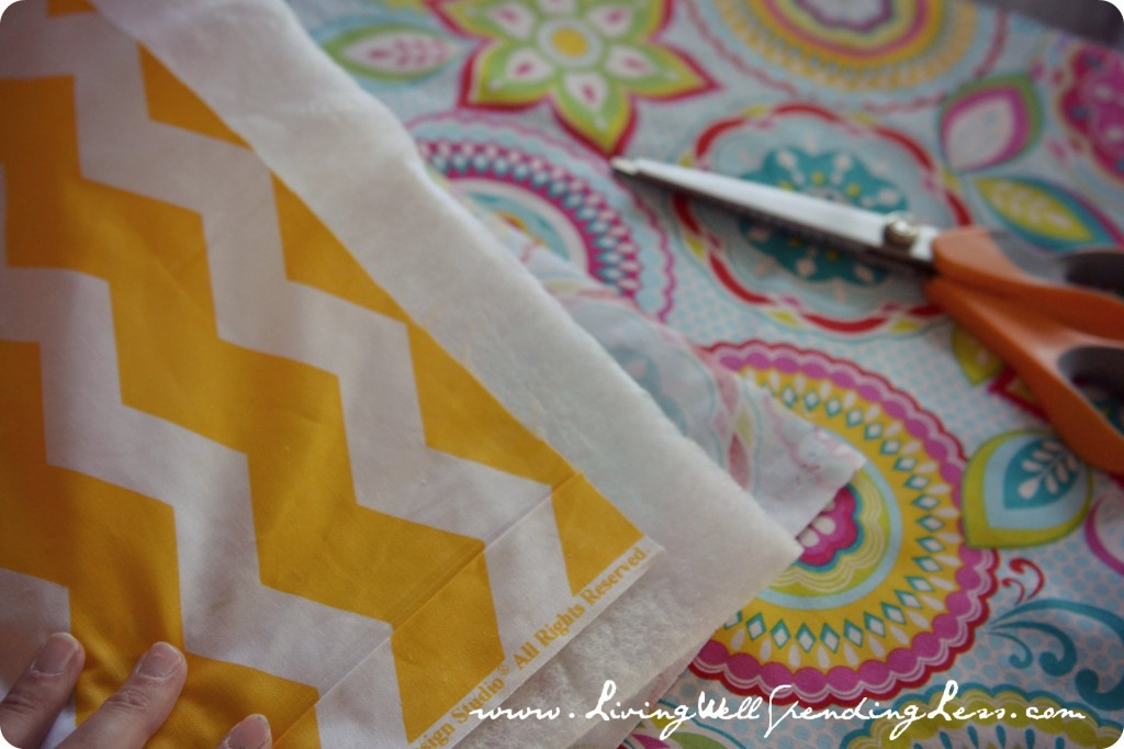 Cut a second contrasting square out of a different piece of fabric.