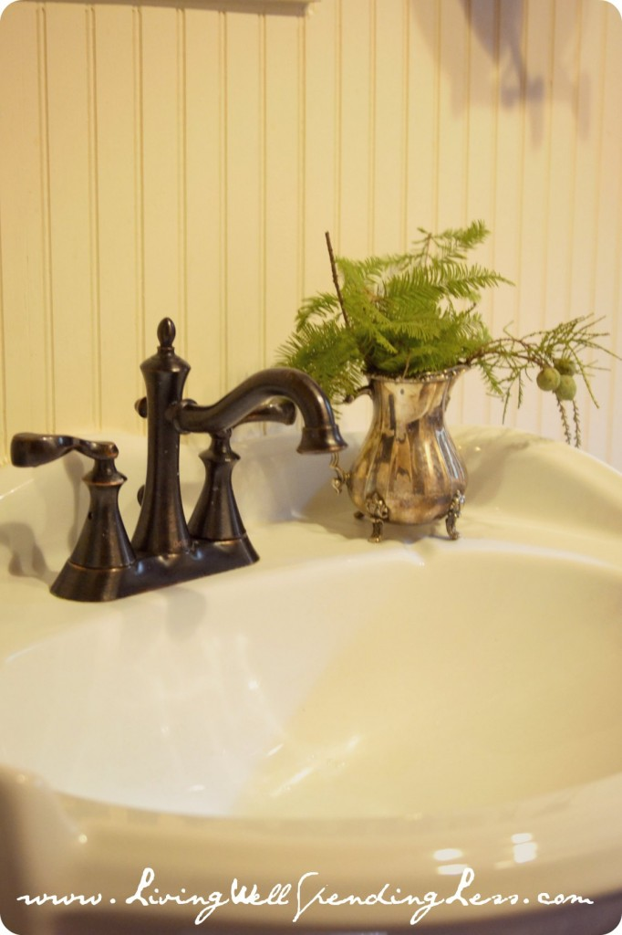 The fresh greenery on this sink adds a fun decor piece to the space.