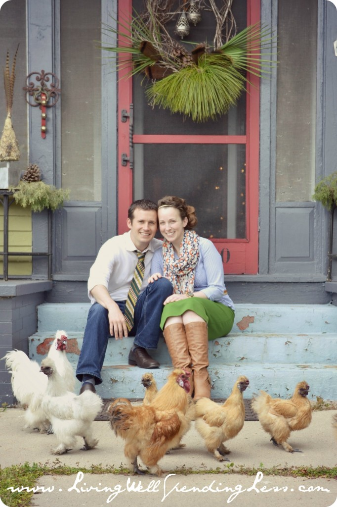 This happy southern couple poses on the steps of their home in front of their chickens.