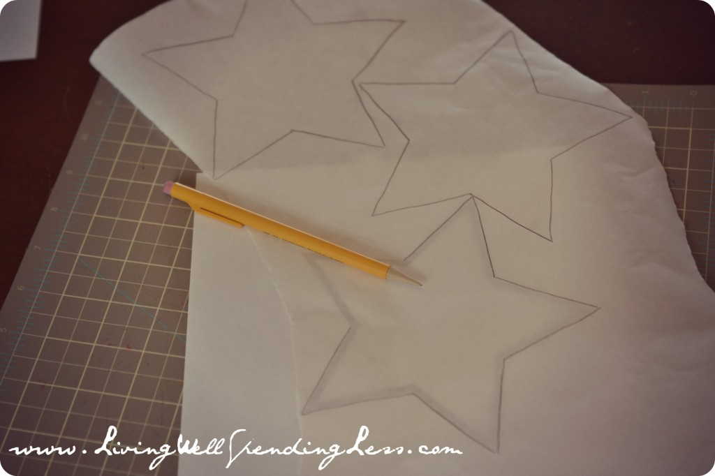 Trace a star shape onto the freezer paper using a pencil.