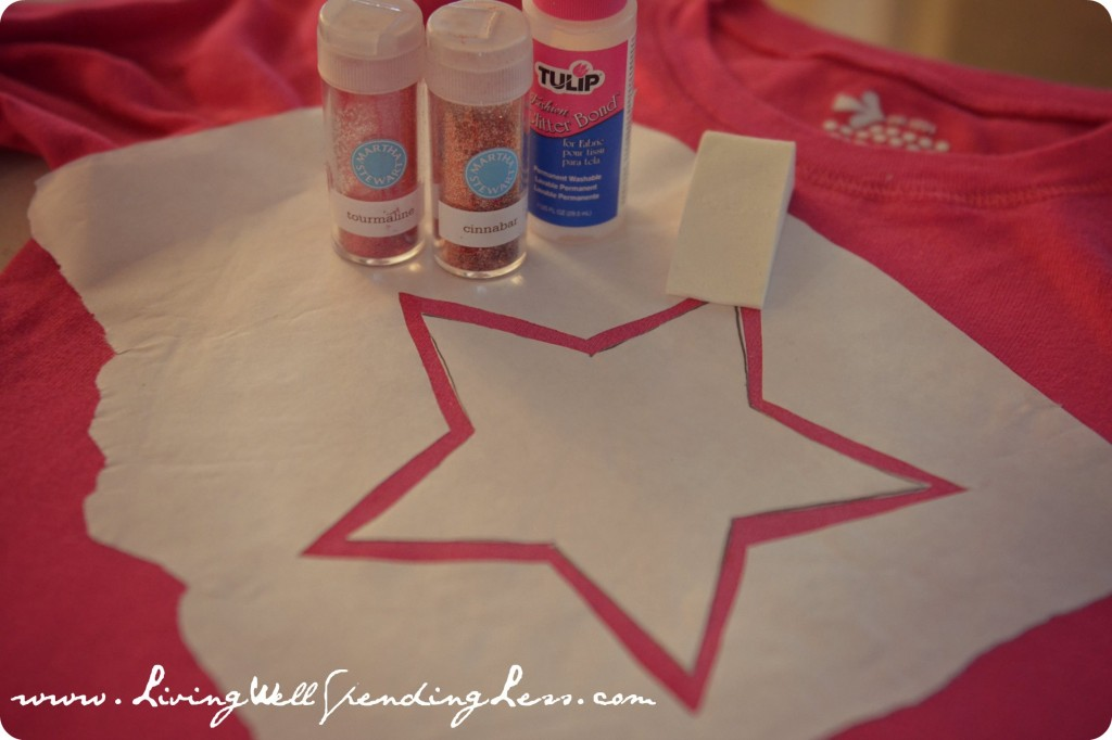 Use a star shaped freezer paper stencil, glitter, a makeup sponge and glue to make a vintage looking t-shirt.