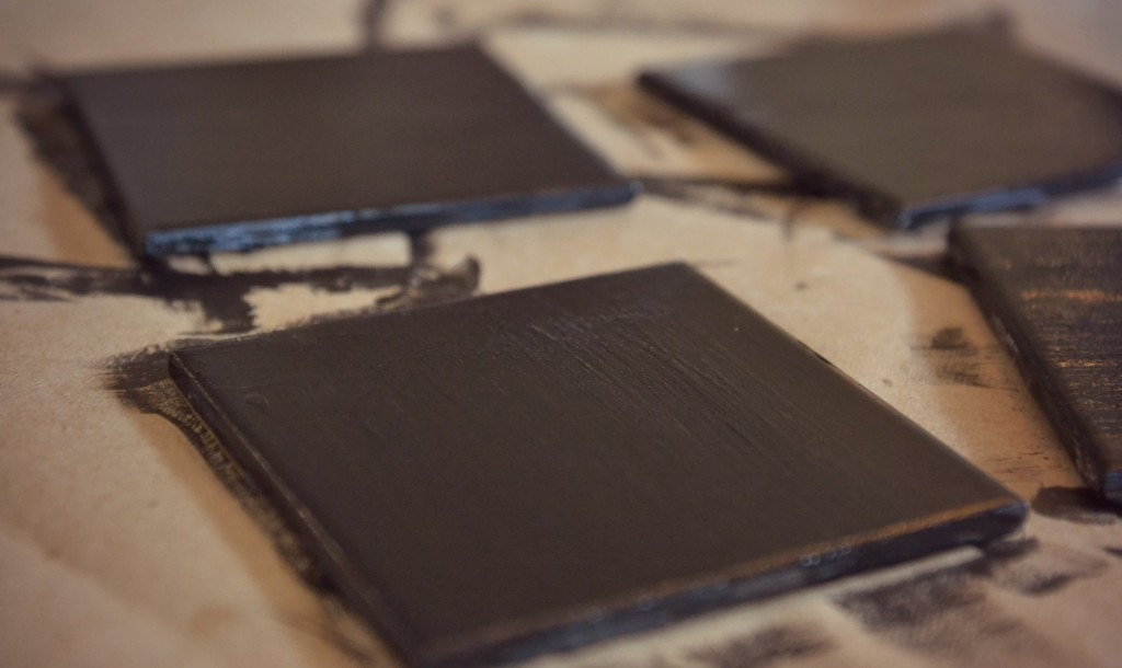 DIY Chalkboard Coaster Set | Three coats of chalkboard paint will cover the tile completely.