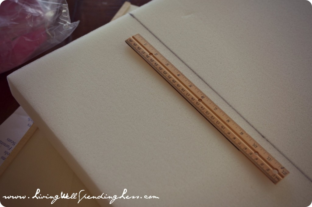 Use a ruler to cut the foam straight to size for the doll bed.