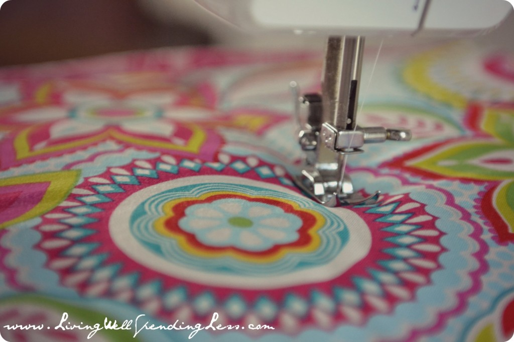 Stitch along the fold lines of your fabric as you make the comforter for your doll bed.