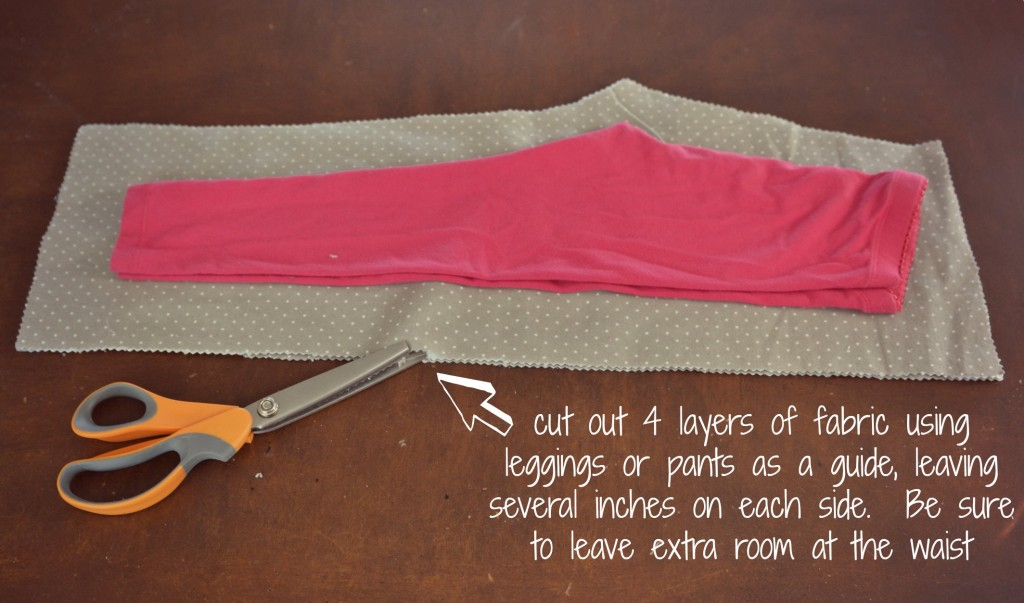 Cut the fabric using the pants as your guide. Be sure to leave inches of fabric on either side.