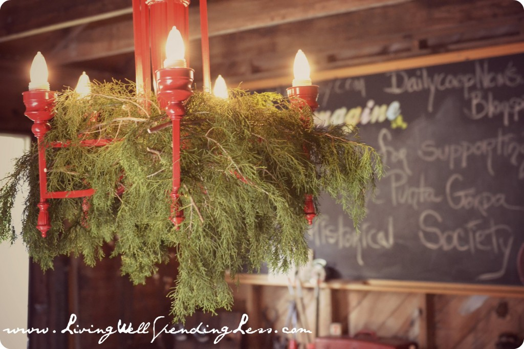 This red chandelier with green moss is festive for the Christmas season.