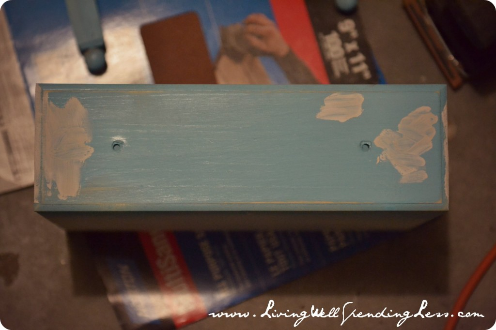Continue sanding and painting all pieces of the doll bed and armoire.