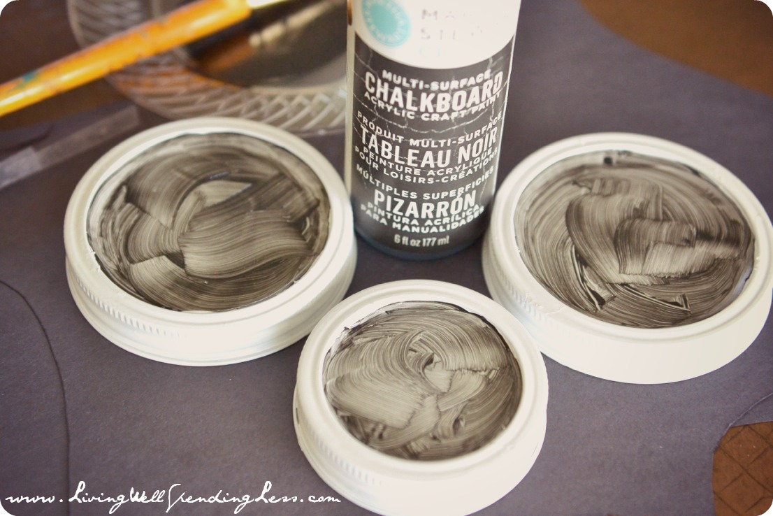 Make these candy jar pedestals customizable by adding chalkboard paint to the mason jar lids.