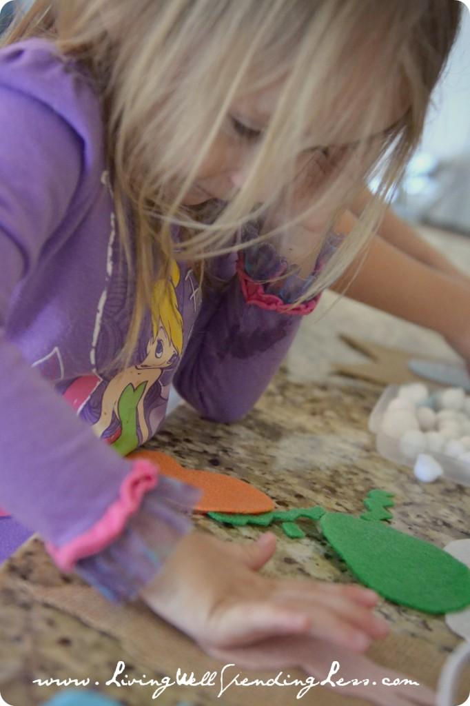 Glue the felt cutouts to the burlap pieces.
