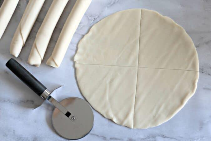 Cut the dough into triangles