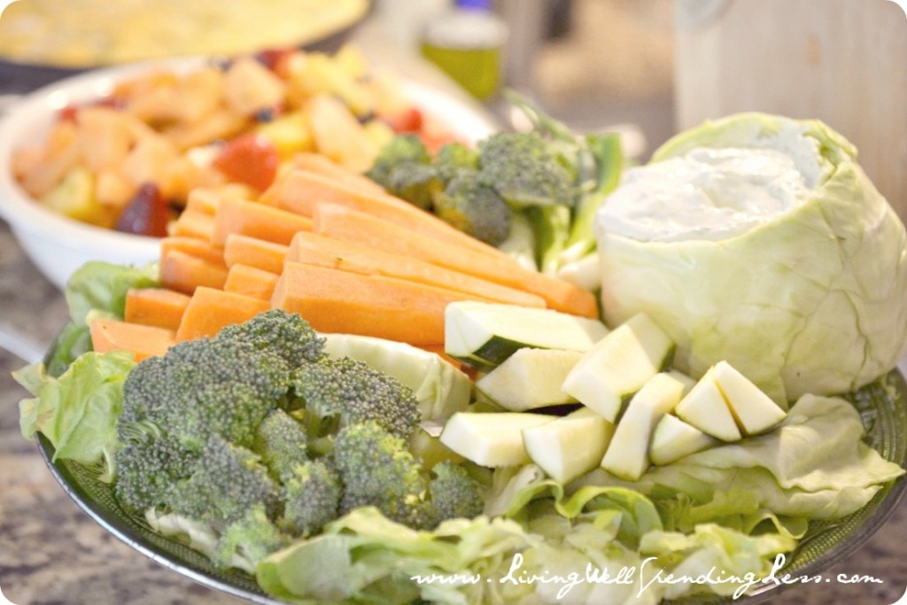 Pot luck and simple dishes like this vegetable platter and fruit salad, make entertaining possible even on a budget.