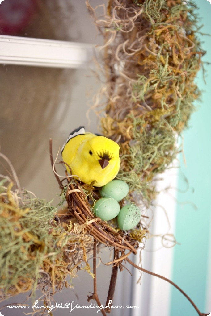 Dollar Tree Spring Wreath--LOVE this project!  Made from supplies picked up at the dollar store, this darling wreath cost less than 7 dollars (and took less than 30 minutes) to make! #DiY #wreath #spring