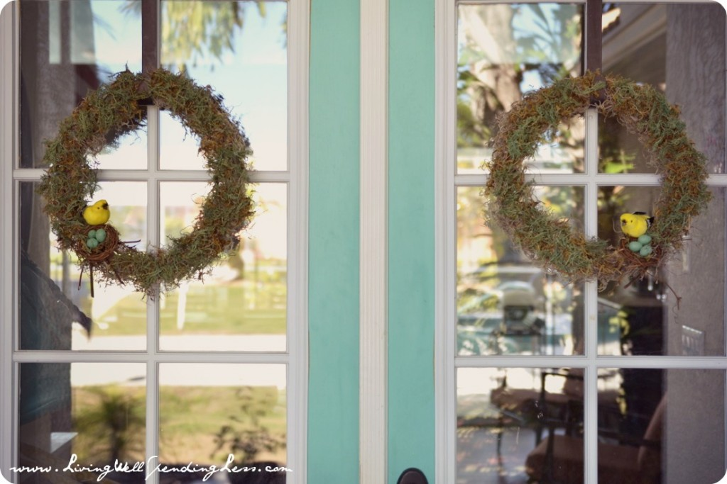 Showcase completed moss wreaths on front doors of your home.