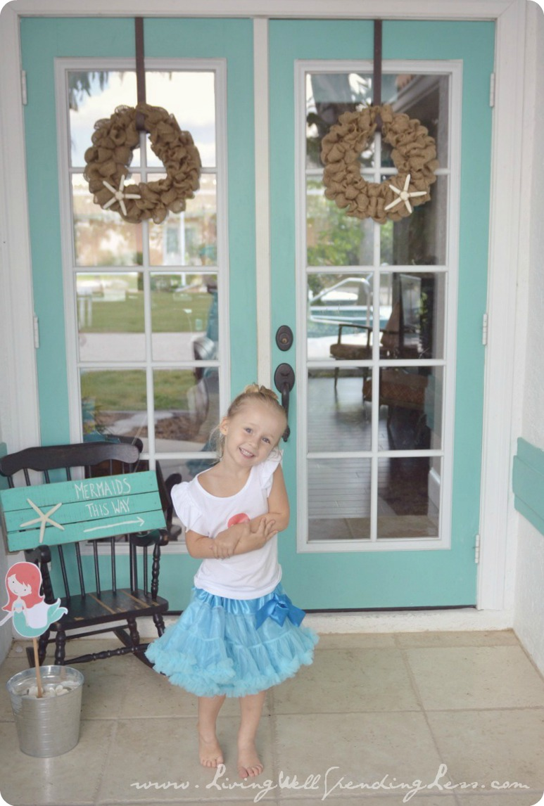 My little mermaid ready for her beachy mermaid birthday party! Here's how we created these darling decorations.