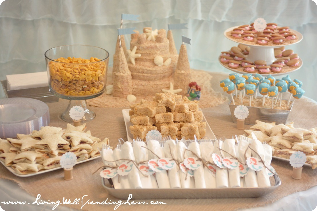This beach themed table is adorable for a mermaid birthday party. the decorations are easy & Beachy Mermaid Party | Living Well Spending Less®