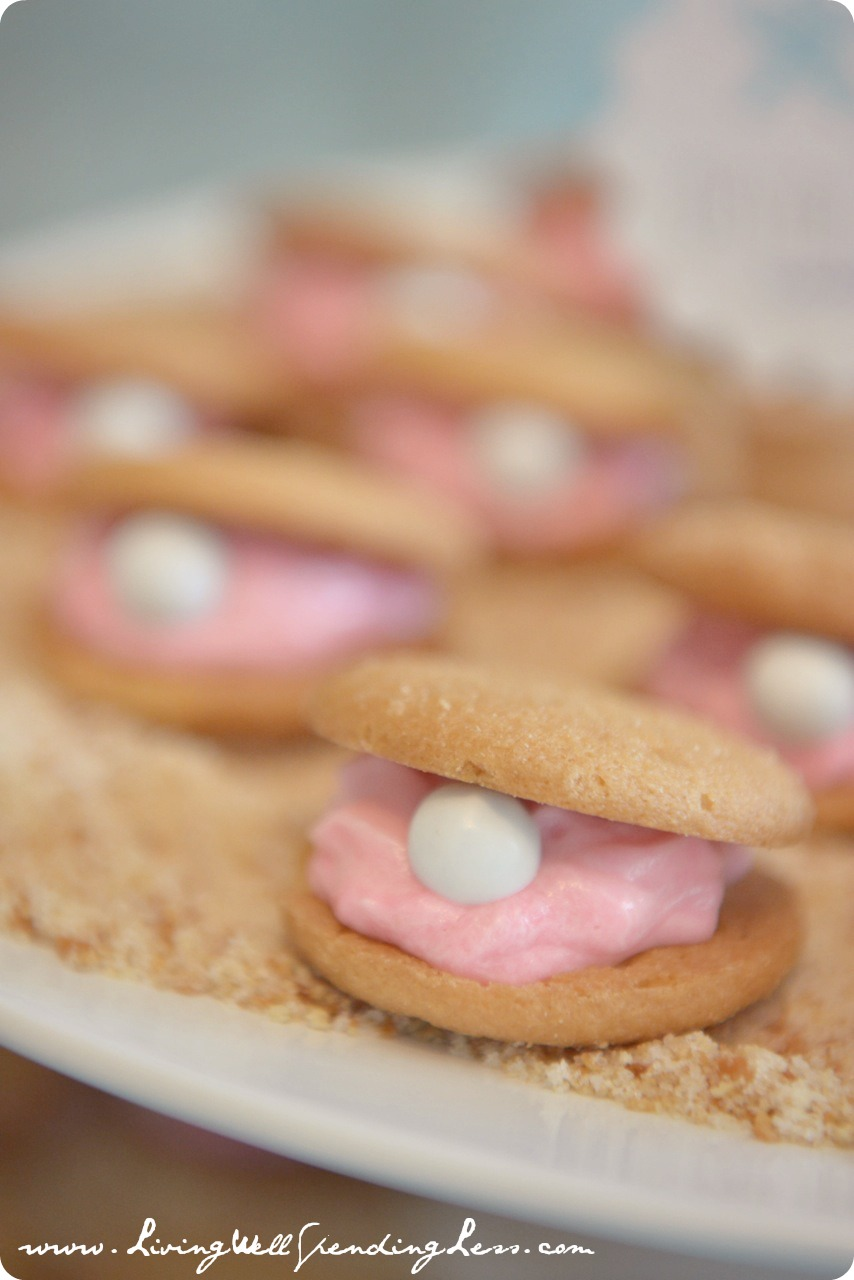 """Oyster"" sandwich cookies are easy to make with Nila wafers, frosting and M&M pearls."