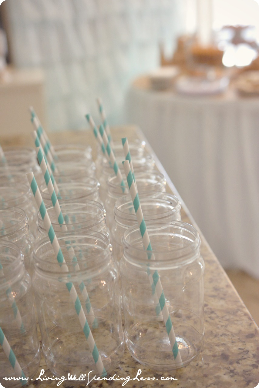 Mason Jars With Blue And White Straws Give A Beachy Vibe To The Party
