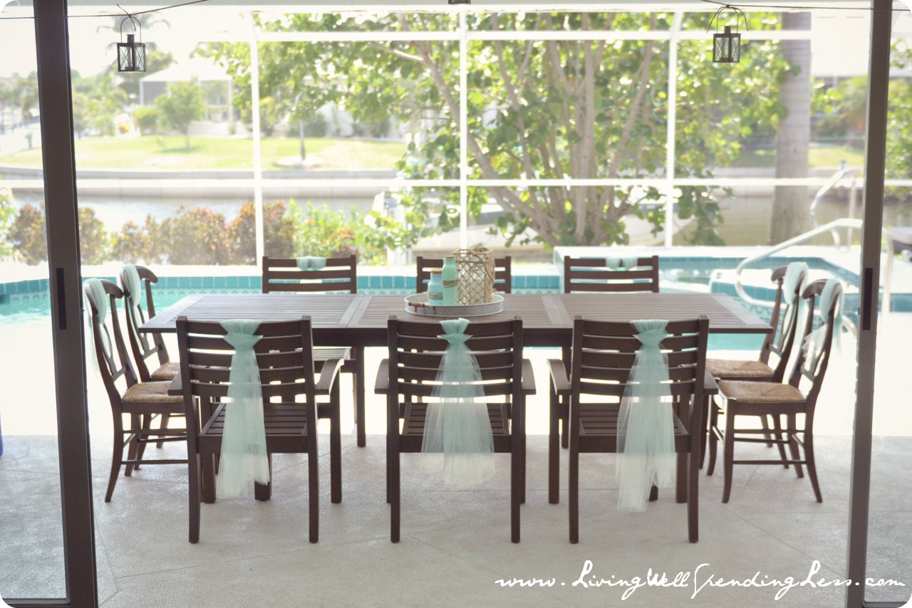 The poolside dining table and chairs were tied with piece of tulle to keep the underwater theme going.