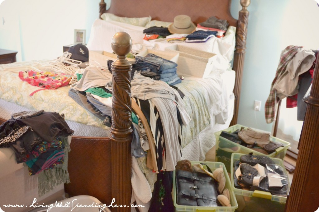 Lay out all your clothing and belongings to organize the bedroom.
