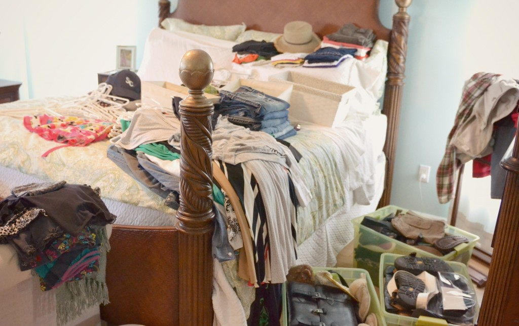 Yes, your bedroom may end up covered in clothes as you sort everything into piles to keep, donate or toss.