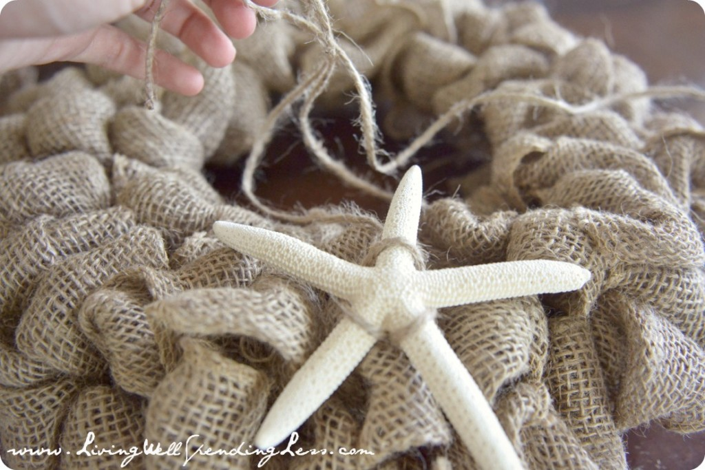Secure the starfish ornament to the front of the wreath using twine.