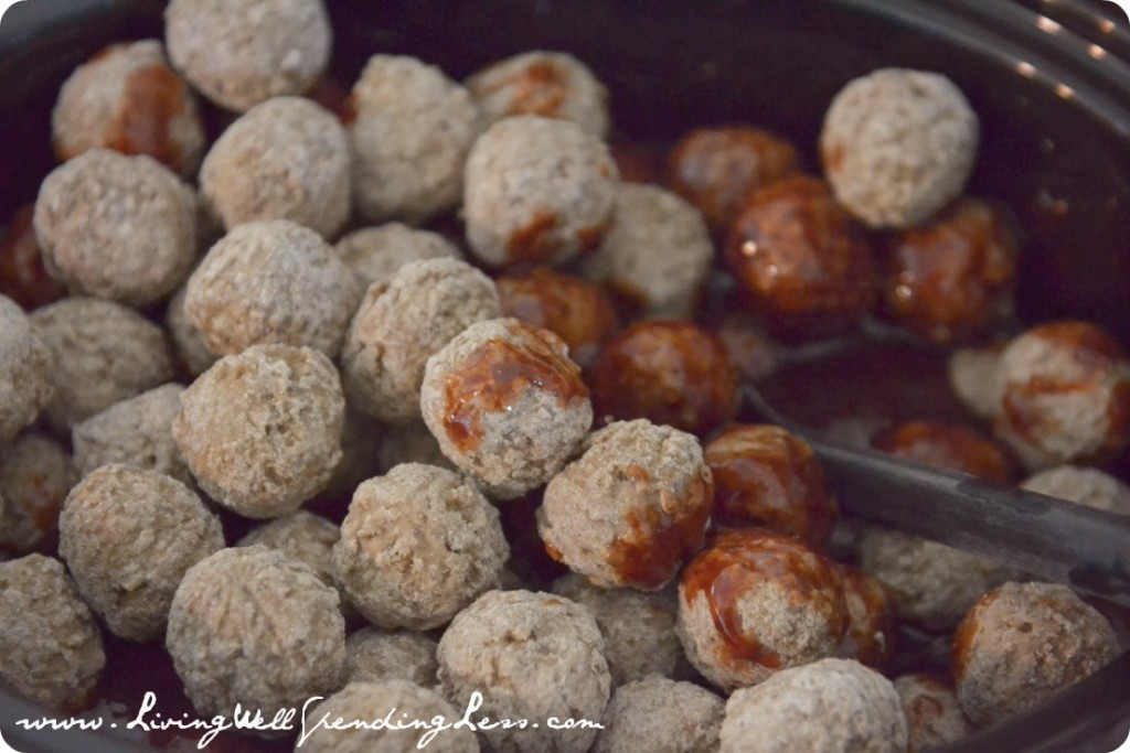 Add your frozen meatballs to the crock pot and cover them with the sauce.