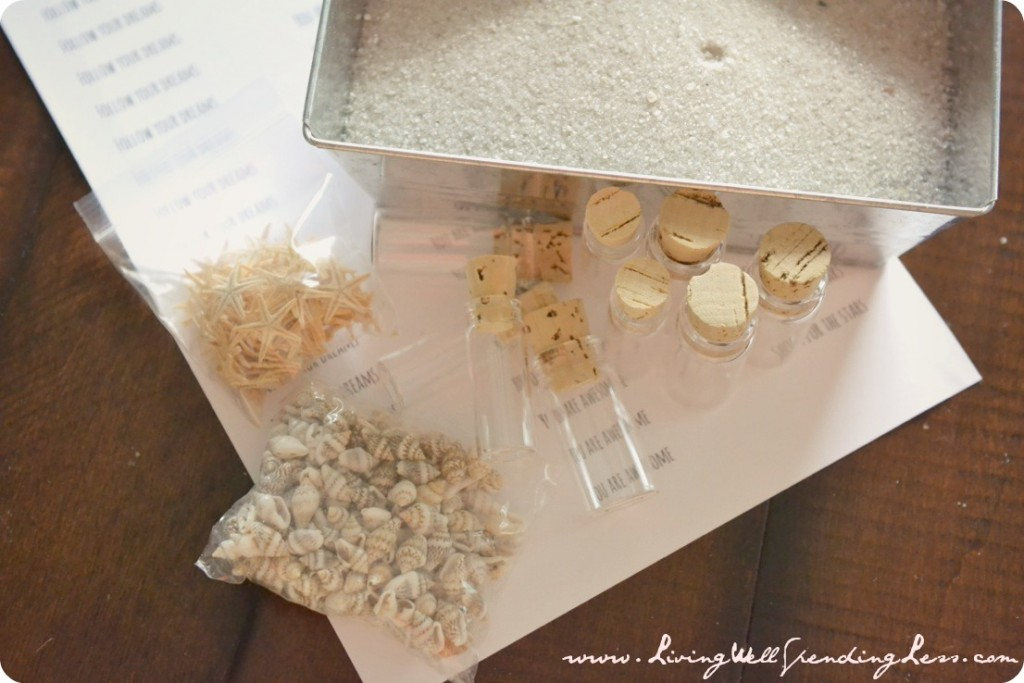 Gather the supplies for your bottles: small glass bottles, corks, shells and message paper.