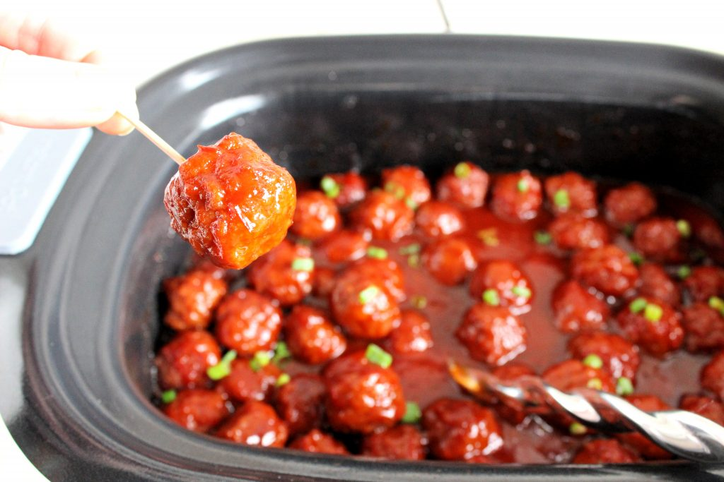 The BEST recipe for Sweet & Sour Crockpot Meatballs! Just 5 ingredients and 5 minutes of time, these meatballs are always the hit of any party or potluck!