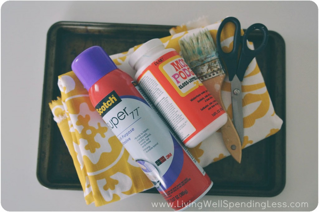 Assemble your materials: Old cookie sheet, fabric, spray adhesive, Mod Podge, paint brush, and scissors/pinking shears.