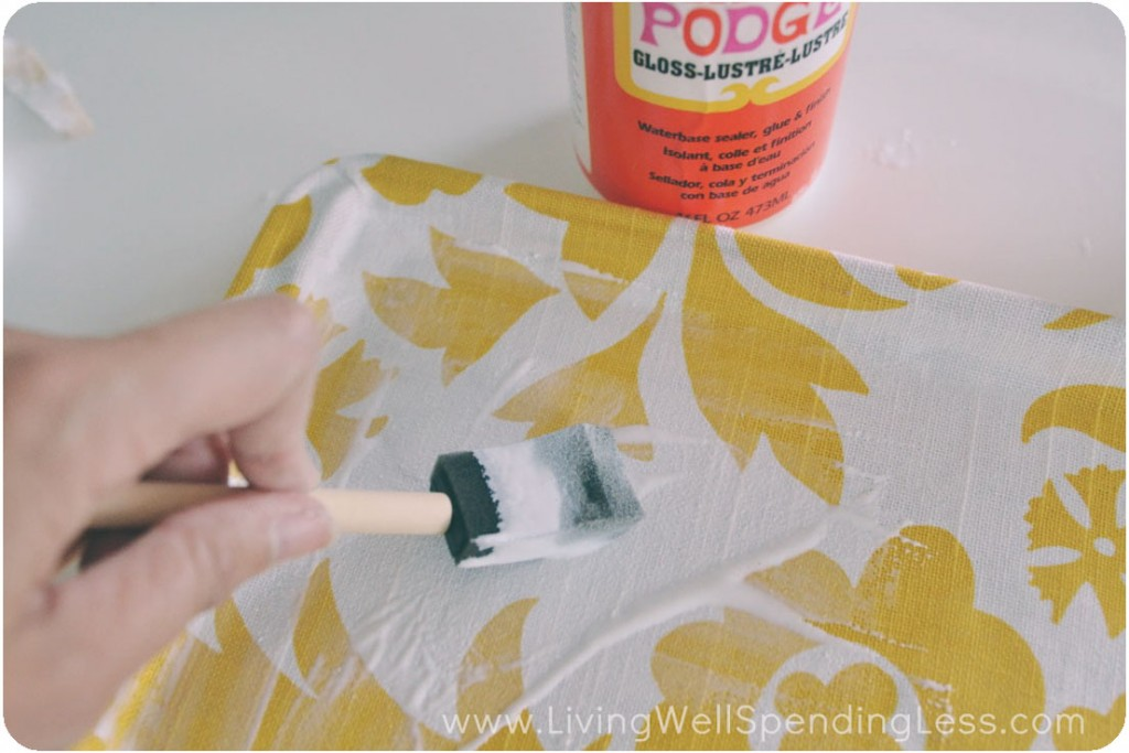 Use a paint brush to coat the top and inner sides of the tray with Mod Podge.