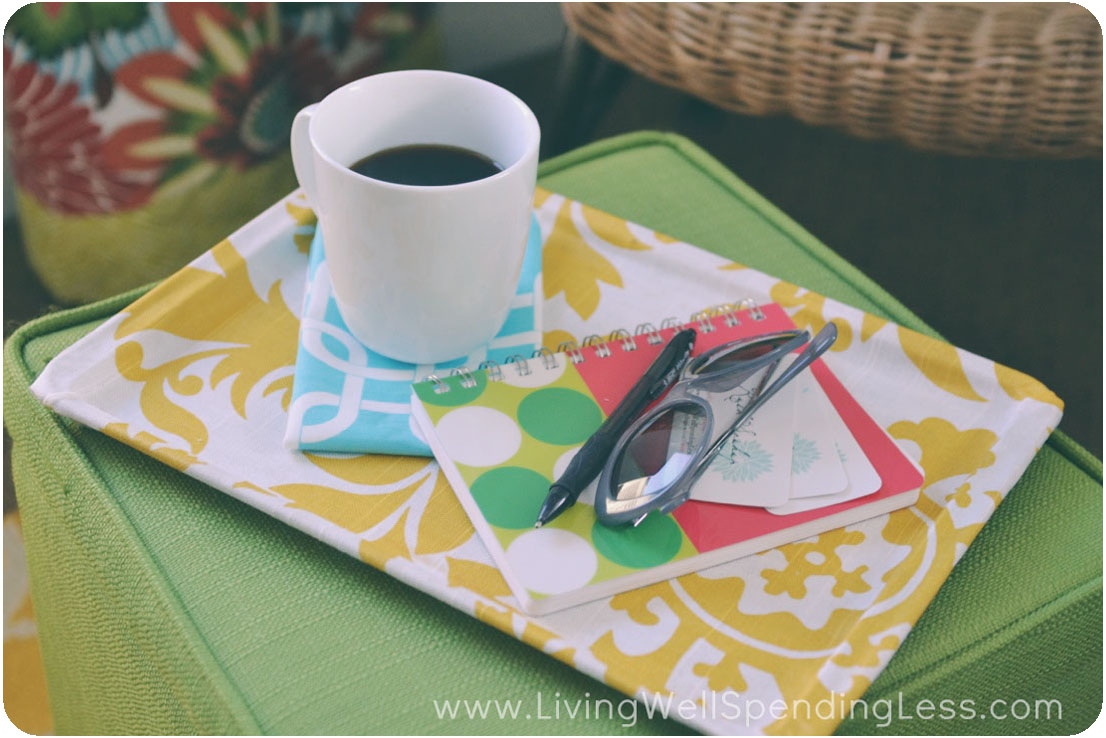 Decoupage can look ultra chic and elegant. This serving tray was covered with fabric, making it a perfect spot to rest coffee and jot down notes in the morning.