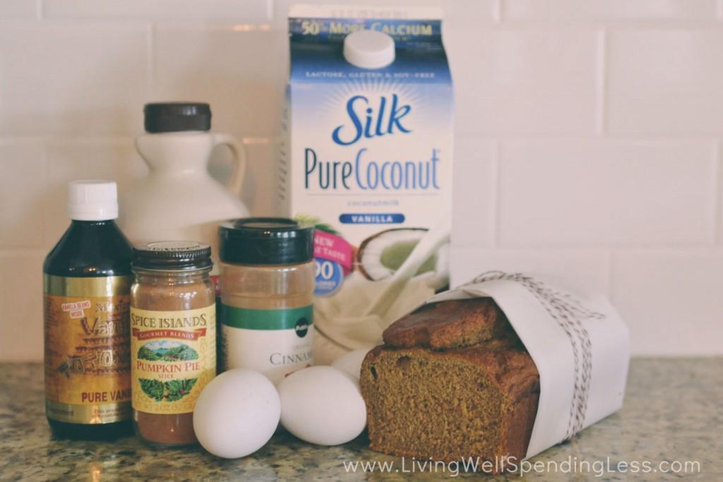 Assemble the pumpkin bread french toast ingredients: pumpkin bread, coconut milk, vanilla, eggs, maple syrup, cinnamon, pumpkin pie spice, butter, coconut oil, and powdered sugar.