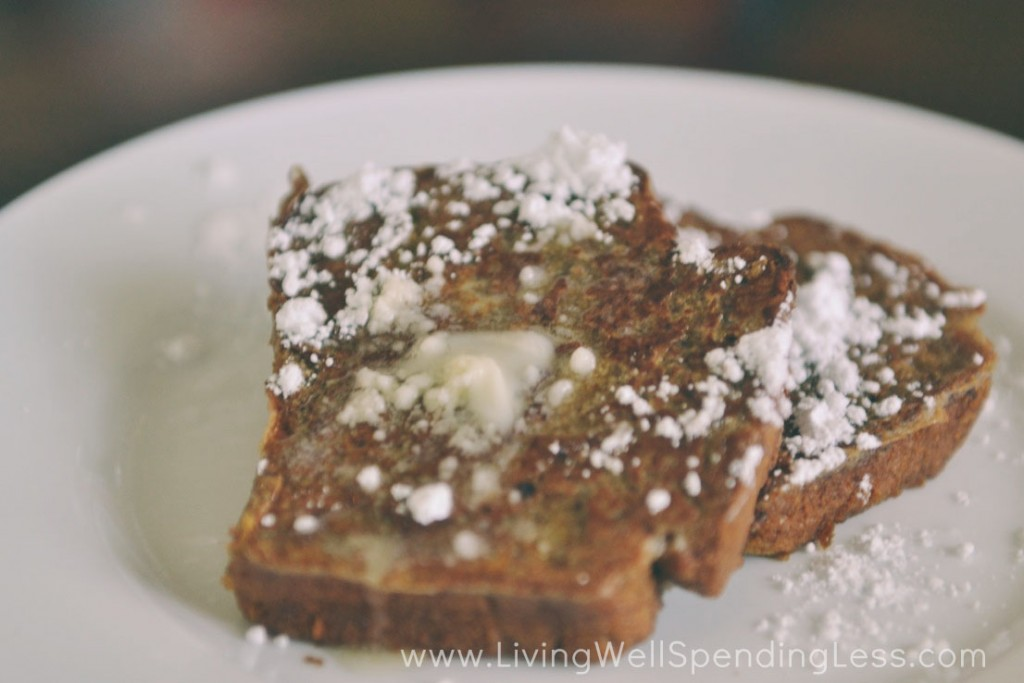 Top pumpkin bread french toast with powdered sugar and serve.