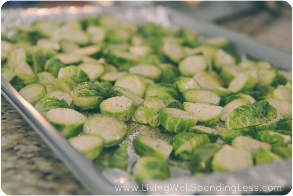 Spread the chopped Brussels sprouts on a tinfoil lined sheet pan and season.