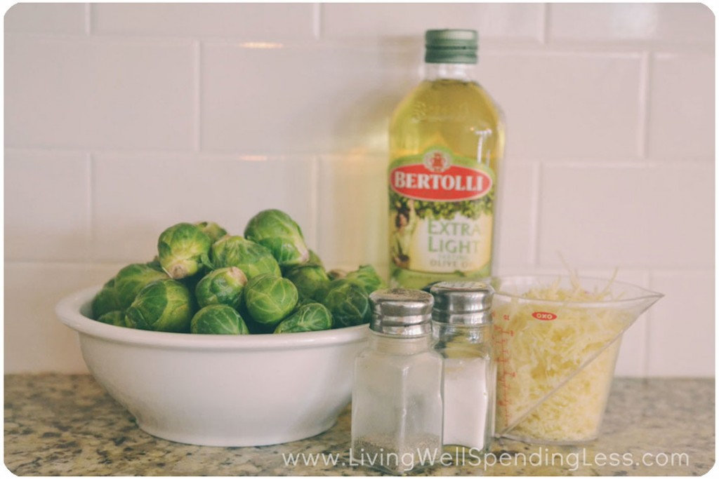 Assemble your ingredients: Brussels sprouts, olive oil, Parmesan cheese and seasoning.