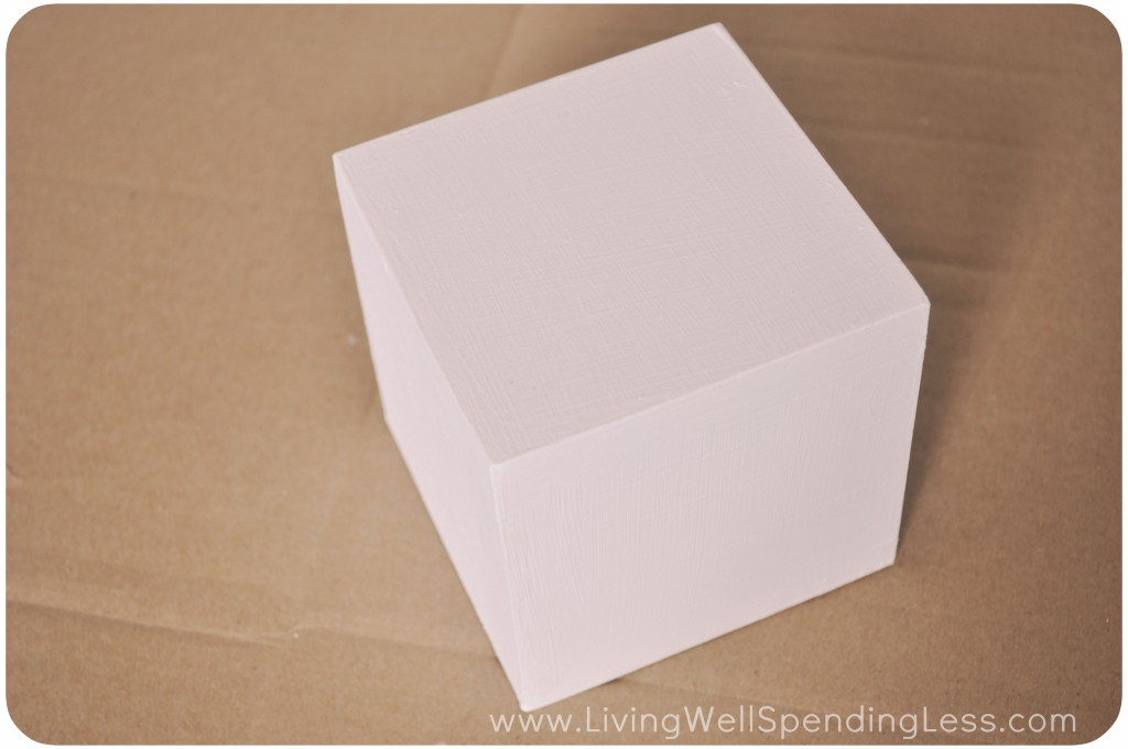 This DIY photo block project starts out with one plain wooden block. I painted this wooden block white.