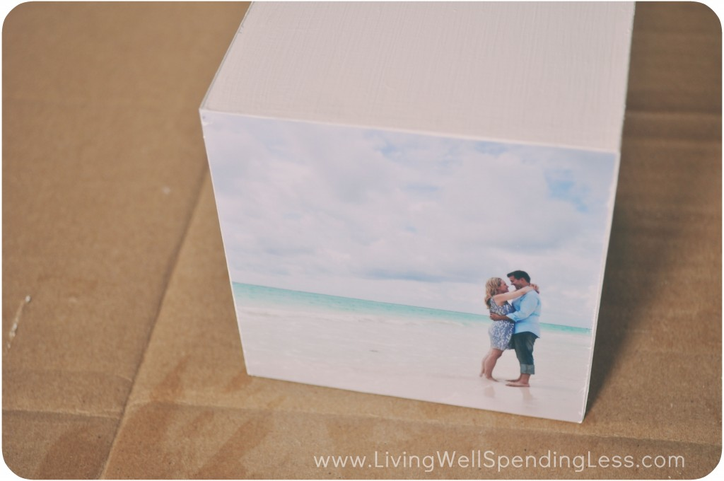 Use modge podge to adhere a photo to one side of the wooden block.