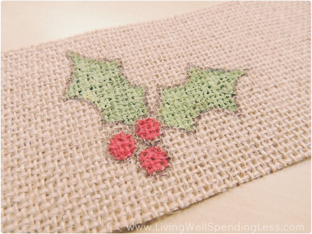 I painted the holly design on my burlap ribbon using red and green acrylic paint.
