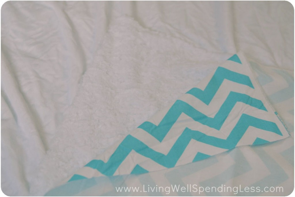 Lay out minky fabric, soft side up then spread out chevron fabric on top.