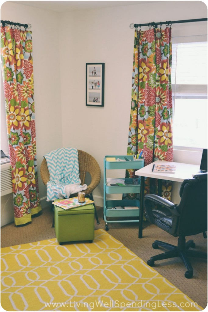 My office got a bright makeover with a yellow rug, yellow and green floral curtains and teal accessories.