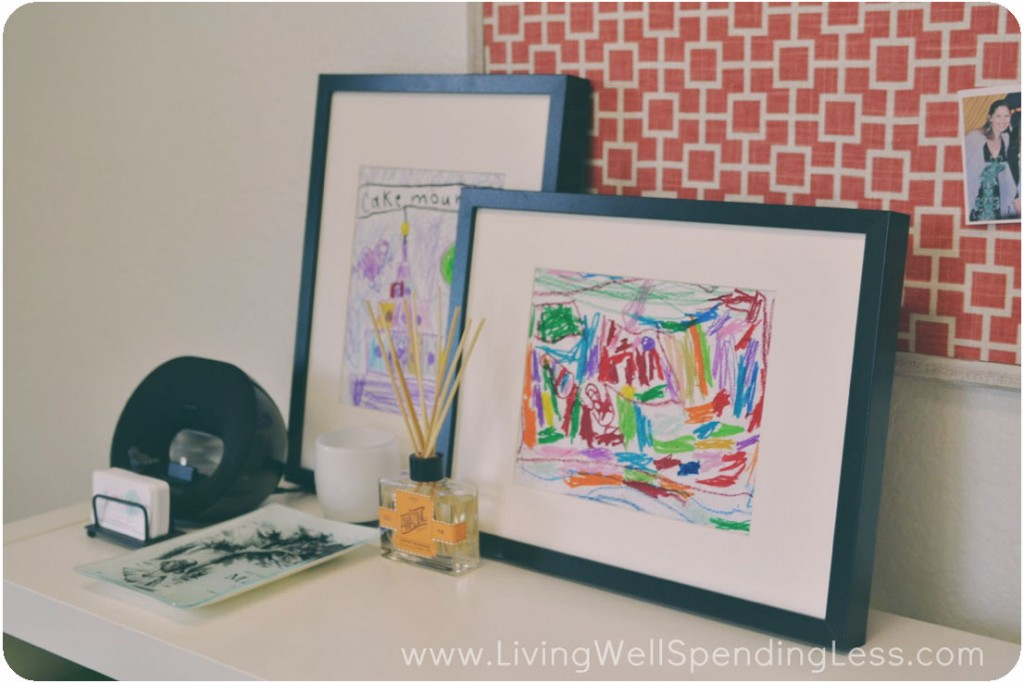 Artwork from my daughters looks bright and cheerful in frames, atop the book shelf. I added a few accessories including a reed diffuser and business card organizer.