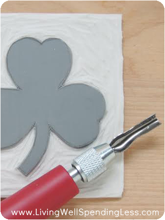 Using a more defined linoleum cutter allows you to get more detail into your design. Work carefully to avoid mistakes.