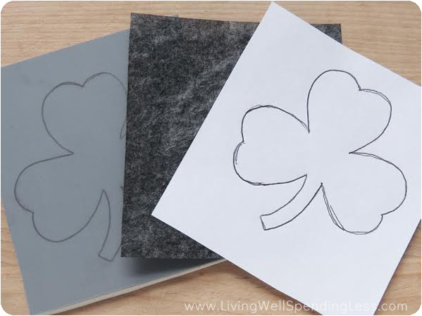 Using a sheet of graphite paper makes copying your stencil on to the linoleum block super easy.