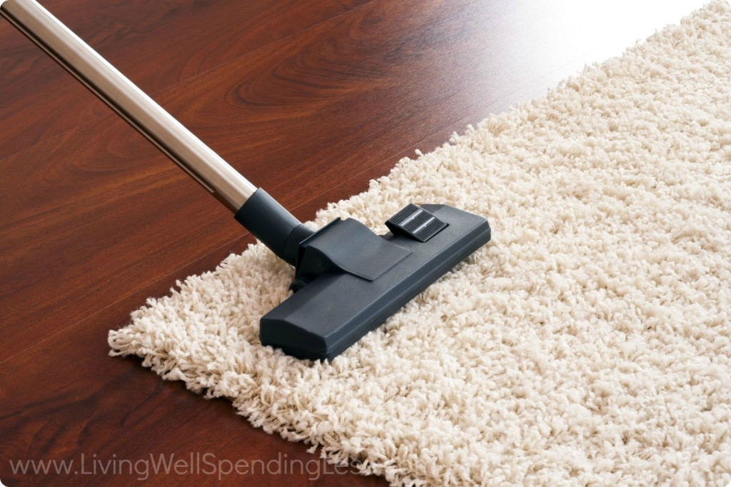 Vacuuming a white carpet.