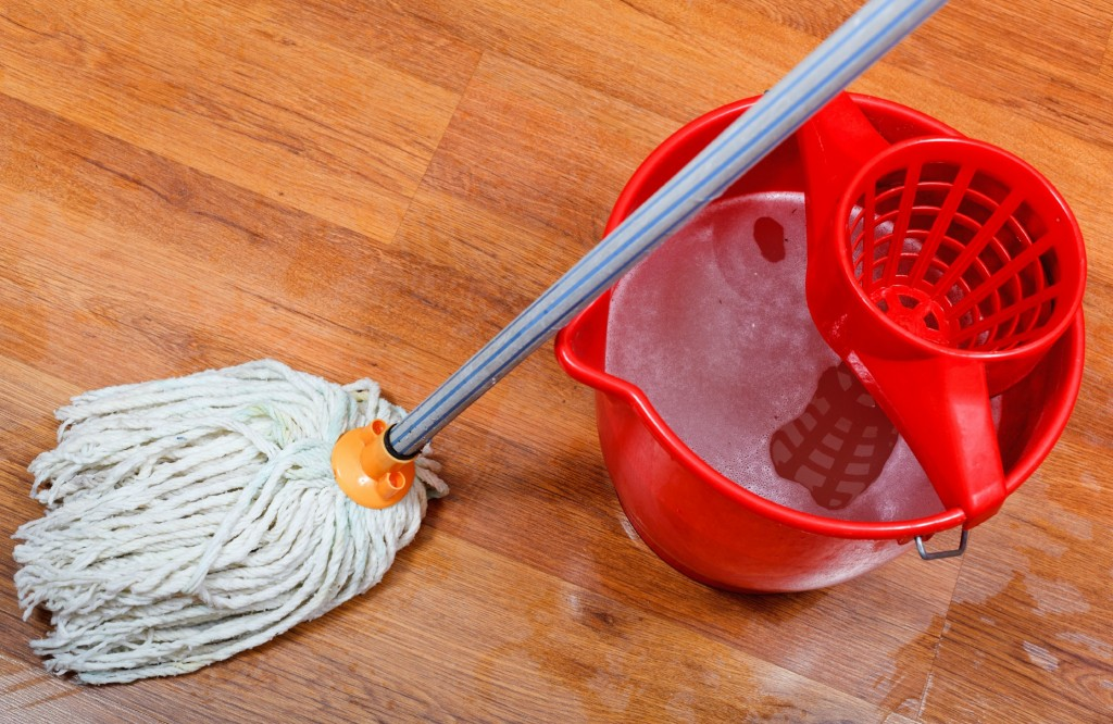 Use a mop and the right liquid when cleaning wood floors.