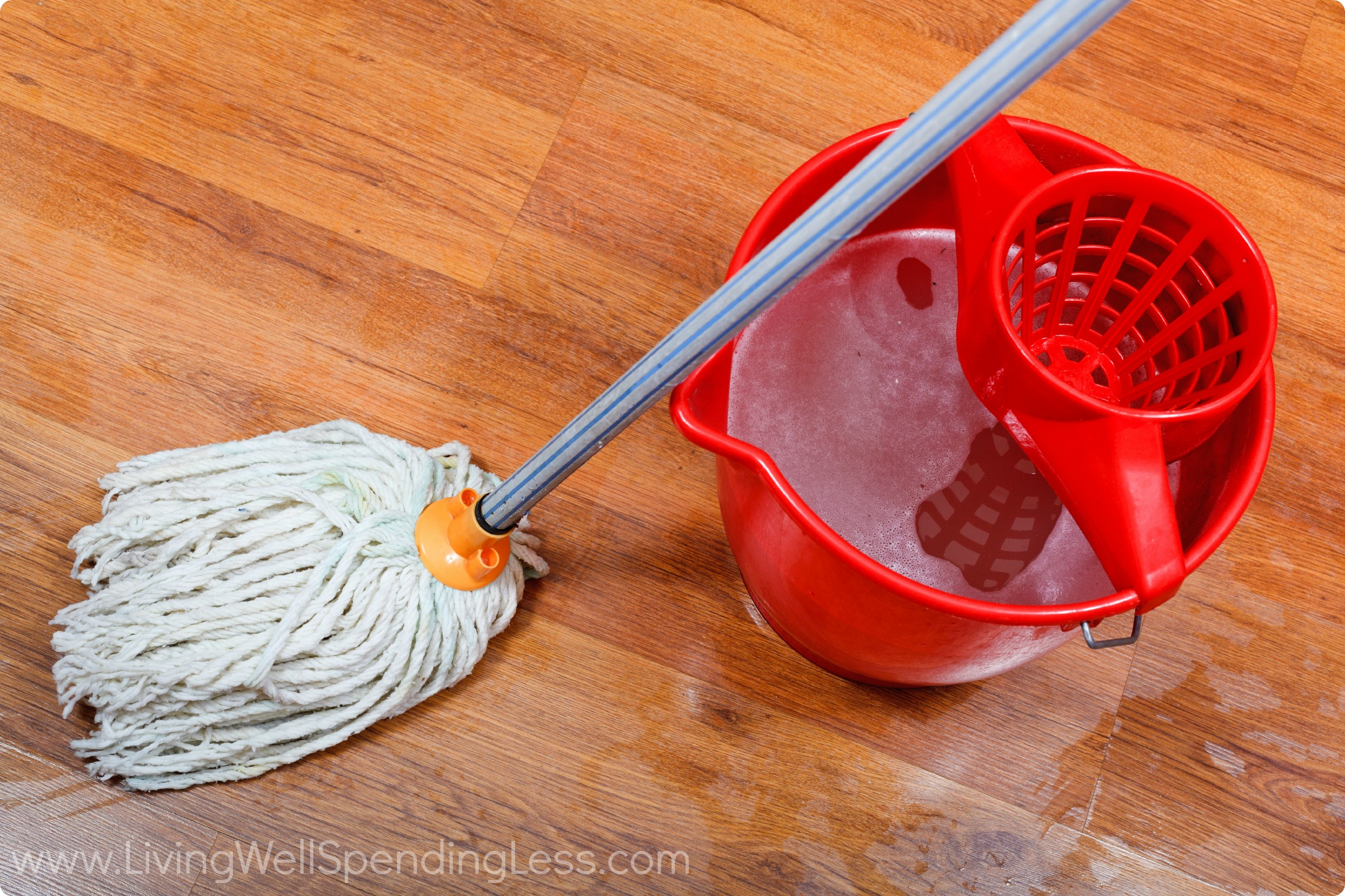 Cleaning Of Wet Floors By Mop And Red Bucket With Washing