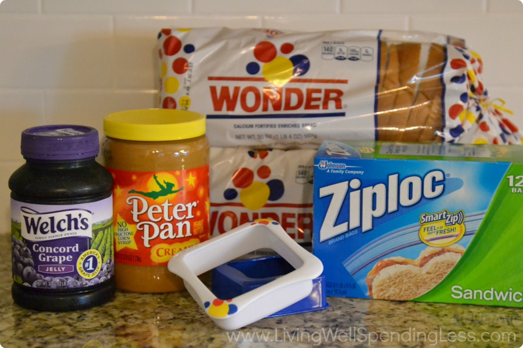 Gather all the ingredients you'll need for these DIY Uncrustables: Jelly, peanut butter, Wonder bread, Ziploc bags and a sandwich cutter.